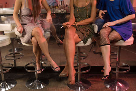 crossed cigarette: Women at a bar