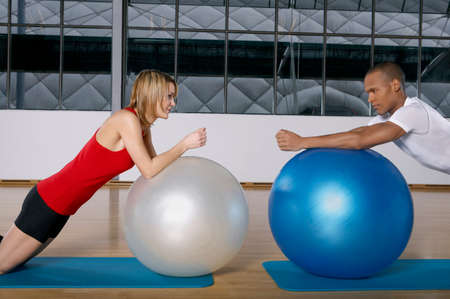 ball stretching: People stretching on the fitness ball