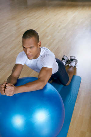 ball stretching: Man stretching on a fitness ball