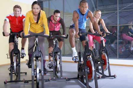 'cycles: People on the cycles in the gym