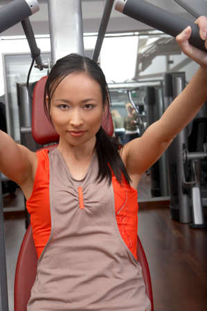tanktop: Woman doing weights in the gym