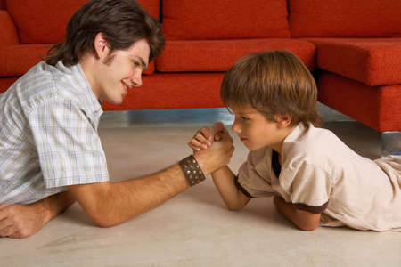 two persons only: Brothers arm wrestling LANG_EVOIMAGES