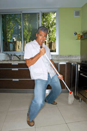 mopping: Man mopping the kitchen floor