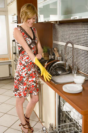 short gloves: Woman washing dishes