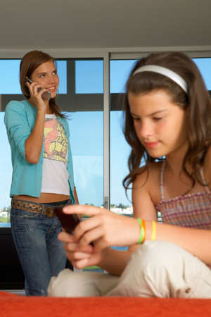 hairband: Sisters using their cell phones