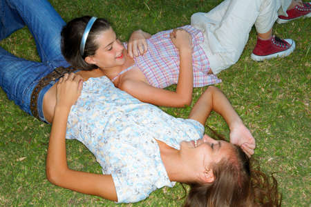 two persons only: Girls lying down in the garden LANG_EVOIMAGES