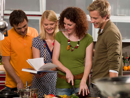 four person only: Four people preparing food in the kitchen