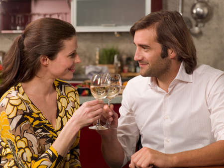 mid adult couple: Close-up of a mid adult couple toasting with wine glasses