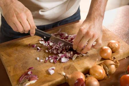 cutting vegetables: Man cutting vegetables