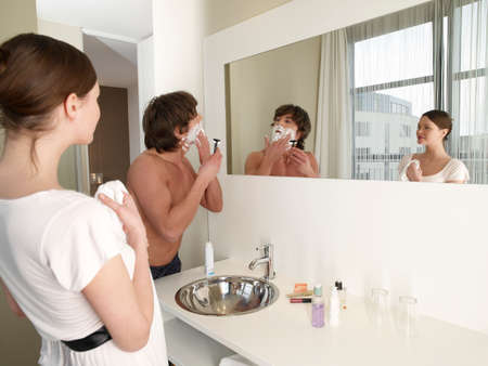 barechested: Woman looking at her boyfriend shaving