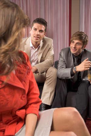 two men talking: Woman and two men talking LANG_EVOIMAGES