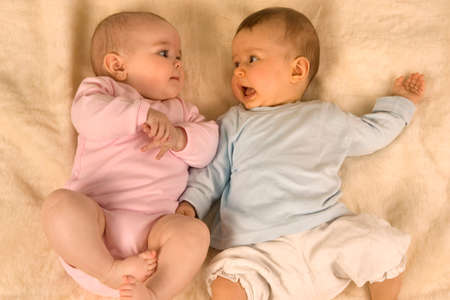 nappies: Two babies lying down together