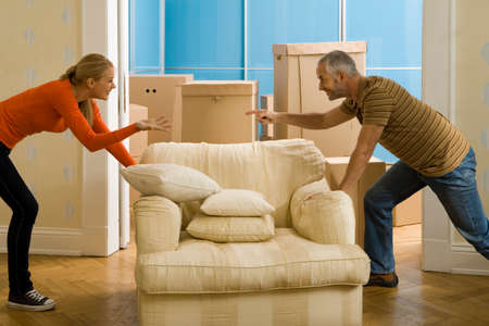 adjusting: A couple adjusting an armchair