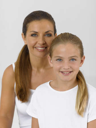 female bonding: Portrait of a girl smiling with her mother