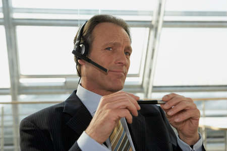 receding hairline: Close-up of a businessman wearing headset