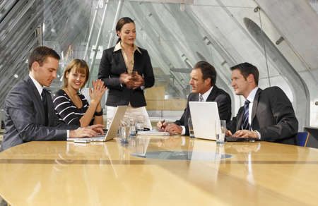 board room: Five business executives in a board room