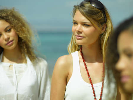 female bonding: Close-up of three young women on the beach