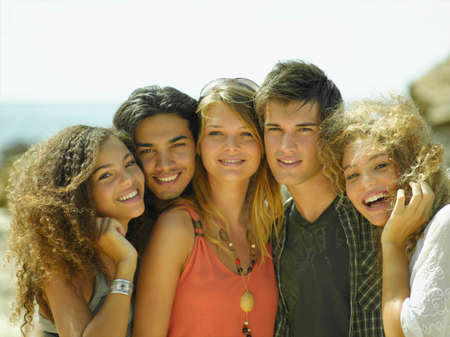 young men: Portrait of two young men and three young women smiling
