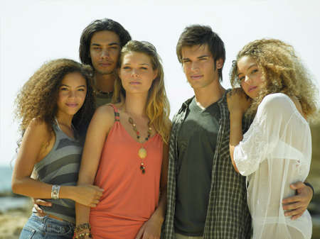 young men: Portrait of two young men and three young women standing together