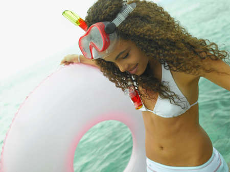 life belt: Close-up of a young woman holding a life belt on the beach