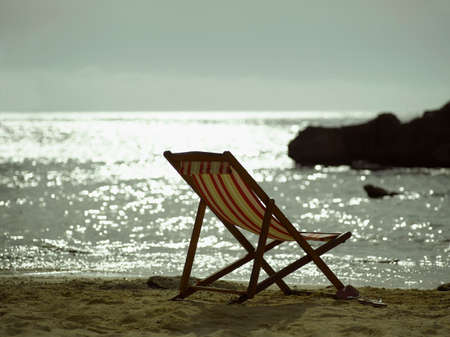 folding chair: Folding chair on the beach LANG_EVOIMAGES