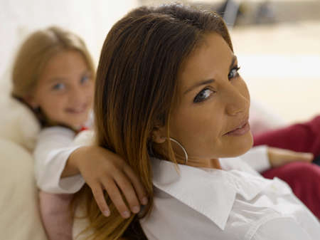 female bonding: Portrait of a mid adult woman smiling with her daughter