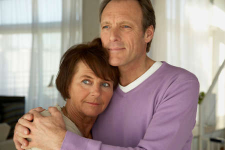 receding hairline: Mature couple embracing each other