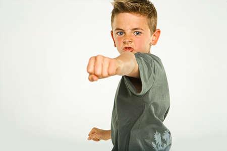 punching: Portrait of a boy punching