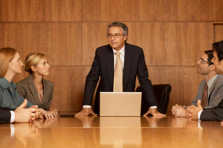 board room: Group of business executives in a meeting