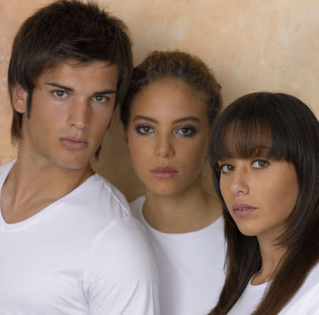 only three people: Portrait of two young women and a young man