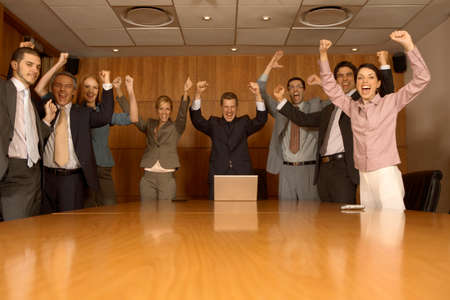 jubilating: Group of business executives celebrating in a board room