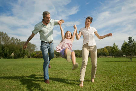 age 40 45 years: Family swinging daughter in air