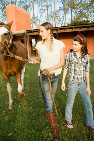 one teenage girl only: woman and girl with horse