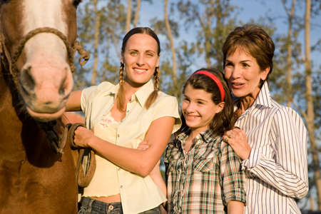 50 to 60 years: Three generation family with horses