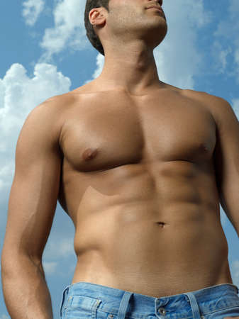 pectoral muscle: Low angle view of a young man standing