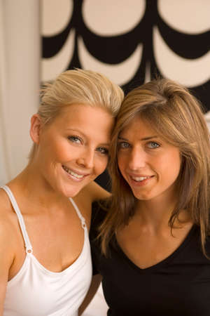female bonding: Portrait of two young women smiling