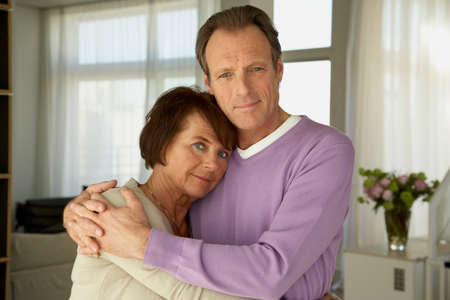 receding hairline: Portrait of a mature couple embracing each other
