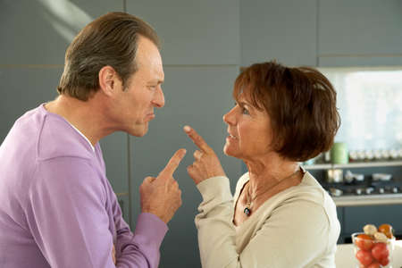 receding hairline: Mature couple pointing to each other