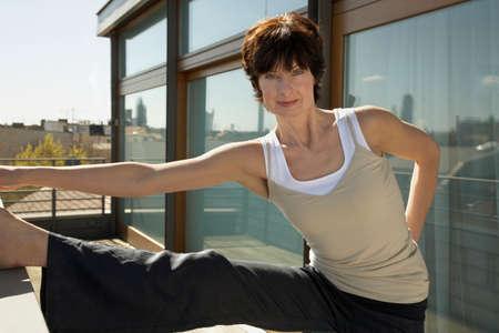calisthenics: Portrait of a mature woman exercising