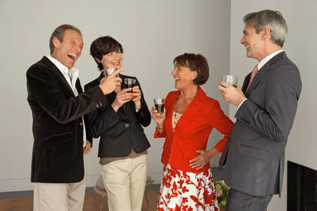 four people: Four people holding wine glasses