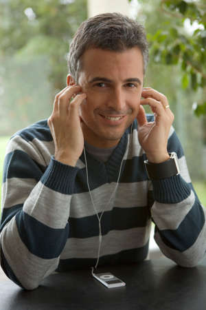 mp3 player: Man listening to MP3 player