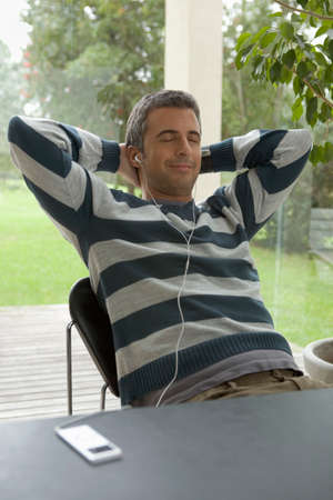 mp3 player: Man relaxing listening to MP3 player
