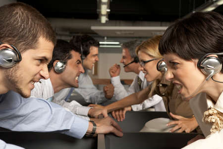 clenching: Group of customer service representatives looking at each other and clenching teeth