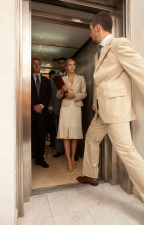 the entering: Side profile of a businessman entering an elevator