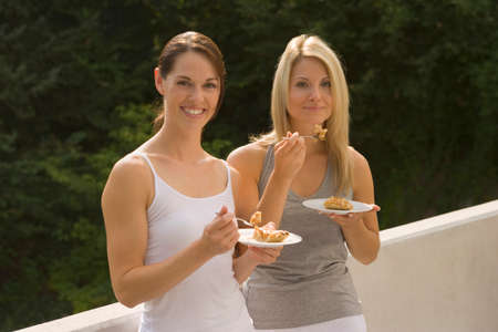 two persons only: Two women eating