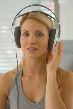 off the shoulder: Woman wearing earphones