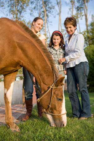 50 to 60 years: Three generation family with horse
