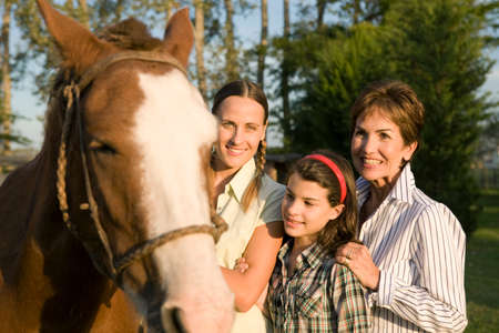 50 60 years: Three generation family with horse