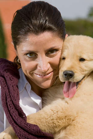 only mid adult women: Portrait of Woman holding puppy