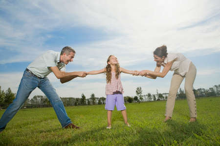 age 40 45 years: Family pulling arms of daughter